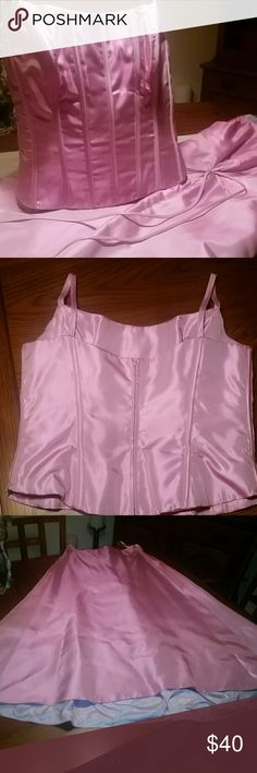 """Lazaro Silk Shantung Formal gown w/ corset top Two-piece stunner in a slightly iridescent soft pink silk Shantung  fully lined with zip-up corset bodice w/ boning with fettuccine straps , top size 16 measures 20"""" pit to pit W laying flat,  and 15"""" L. Skirt sz.14  w/ 32"""" waist , flared slight asymmetrical bottom 39"""" front L, 34""""bk , gathered in back with tie and zippered. Worn once small hole on fabric seen on pic 4 near of tie in back. formal occasion or prom, Belle of the ball, corset top…"""