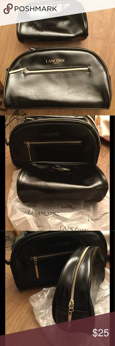 Lancôme makeup bags 2 pc set Brand new 2 pc make up bags . Great for travel or to the gym. Lancome Bags Cosmetic Bags & Cases