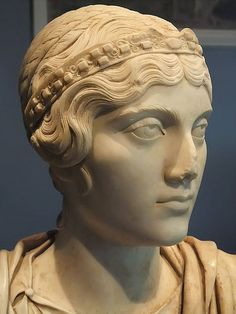 Portrait Bust of a Roman Woman with hair styled after the Empress Faustina 140-150 CE Marble