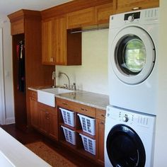 Laundry Room with stacked laundry washer and dryer, countertop with sink.