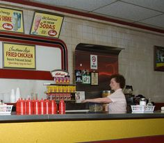 The American Diner: Shown here is a familiar scene from days gone by: A waitress getting coffee & such for a customer in an old-time, unidentified Diner - Photo by Bob Jagendorf via Flickr