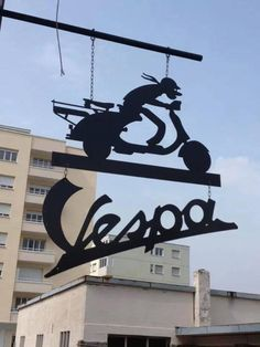Vespa store in Martigny, Switzerland. @vintageclothin.com