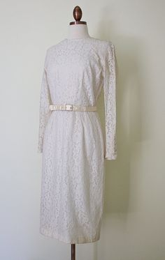 1960s ivory lace sheath dress with sating belt by inheritedattire