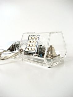 vintage lucite & chrome phone. A pinner says: i would buy this for @Nikka H. Why H. Why Lanzarone if i were rich, & if anyone actually still used house phones. $175
