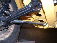Front suspension with adjustable torsion bar