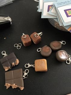 Chocolate, peanut butter and chocolate, and caramel candies, all made with polymer clay.