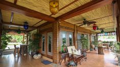 Taking inspiration from old Boholano houses, the owners maximized a lot by building a rustic Filipino retreat that highlights a splendid view and local materials Filipino Architecture, Tropical Architecture, Philippine Architecture, Tropical Beach Houses, Tropical House Design, Tropical Furniture, Tropical Interior, Filipino House, Bali