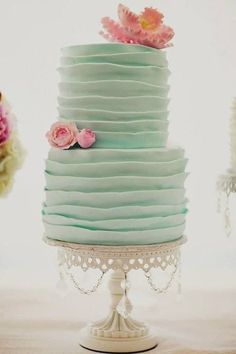 Wedding Inspiration | Wedding Cake -- Love the mint and pink, the tall, thin shape, and the simple ruffles.