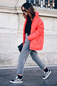 Red puffer jacket, black turtleneck sweater, grey ankle pants, grey sneakers, black sunglasses, black shoulder bag - puffer jacket, puffer jacket outfits, fashion, fashion 2017, winter fashion, winter outfits, winter fashion trends, fashion trends 2017, street style, casual outfits, comfy outfits, travel outfits.