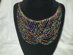This colorful necklace is handmade. The design was carefully created and is made of various colors. Handmade Beads, Handmade Jewelry, Unique Jewelry, Seed Bead Patterns, Beading Patterns, Seed Bead Earrings, Beaded Earrings, Bead Jewellery, Beaded Jewelry