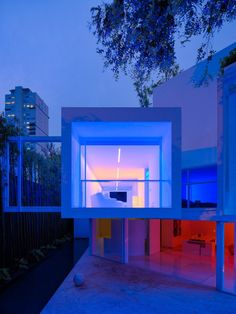 The colored lights in the home change from warm honey hues to deep reds to light blues and purples. #dwell #modernlatinamericanhomes #mexico #colorfuldecor #contemporaryart #modernarchitecture