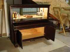 Re-purpose an upright piano - sometimes you can get them free just for hauling them away...