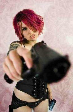 Redhead gun tattoo