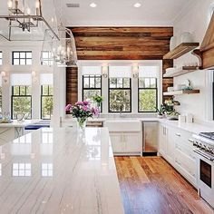Kitchen goals.  I love the mix of clean lines with that rustic reclaimed wood wall. Perfection! .  @petersonfunding