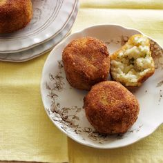 Arancini with Peas and Mozzarella | Grace Parisi's Calabrian grandmother always used plain white rice to make her incredible arancini (rice balls), but she prefers to cook with plump arborio because she thinks it makes the insides creamier.