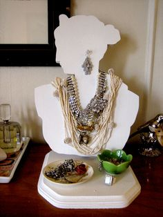 necklaces draped over bust