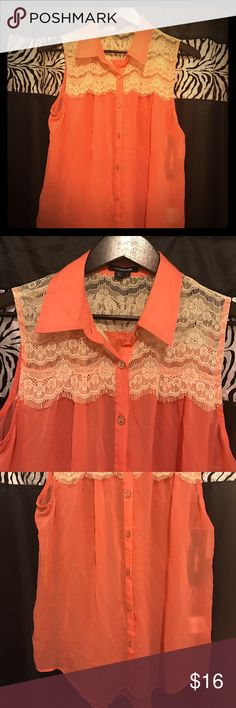 🖤BEAUTIFUL BLOUSE🖤 Beautiful sleeveless collared blouse••coral color w/ivory lace••7 buttons going up the front••100% polyester w/lace across the front top and back top••BNWT••PERFECT CONDITION!! My Michelle Tops