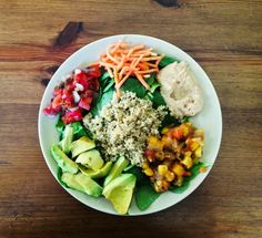 A delicious, nourishing lunch! Spinach with quinoa, carrots, avocado, hummus, pico de gallo, and mango papaya salsa.