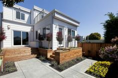 The backyard of the Bernal Heights home features a redwood deck and planting boxes, as well as a newly installed irrigation system. Photo: S...