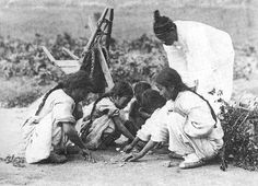 Old picture of children playing GONG-GI