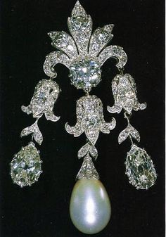 Queen Mary's 'Women of Hampshire' Pendant Brooch - In 1893, the 'Women of Hampshire' committee, led by the Duchess of Wellington, collected funds to buy a wedding gift for Princess May of Teck. The group selected a fine diamond pendant with a pear-shaped pearl drop. By 1911 the pendant had been converted into a brooch. The Queen inherited the brooch in 1953.