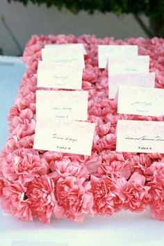 Could be FABULOUS for name tags for preference round! pink-carnation-escort-card-bed