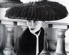 Cartwheel hat by Legroux Sisters, photo by Norman Parkinson 1952