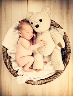 Photo Idea - Take a monthly photo using the same bear from newborn to age one (or older)