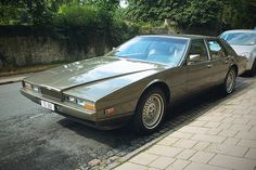 The Aston Martin Lagonda was a luxury four-door saloon built by Aston Martin of Newport Pagnell, England, between 1974 and A total of 645 were produced. The name was derived from the Lagonda marque that Aston Martin had purchased in There Aston Martin Vulcan, Aston Martin Cars, Aston Martin Lagonda, Classic Aston Martin, Classic Cars British, British Car, Bond Cars, Courses, Sport Cars