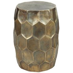 "The Hive Spot accent table stands with stunning dimension. This drum-shaped hammered metal accessory captivates with honeycomb-inspired texture, elevating modern spaces with bold and alluring design. Doubling as chic seating, this piece gains added glamour from an antiqued brass finish. Antiqued brass finish, hammered metal; 13.8"" Dia x 19.3""H"