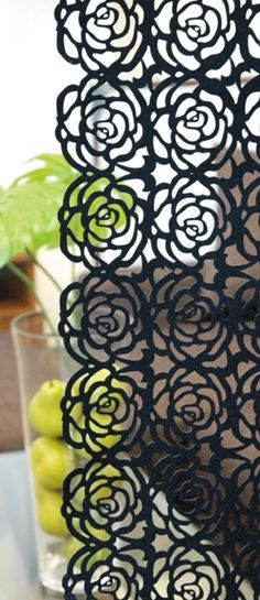 Laser cut table runner as window covering