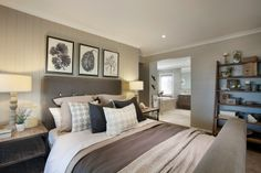 This classic master bedroom style has a farmhouse feel with French provincial table lamps, rustic oak timber bedside tables and floral artwork. The weatherboard feature wall and buttoned linen bed frame bring out a rustic vineyard influence. As displayed in Waldorf 46 at Ambrosia Estate.