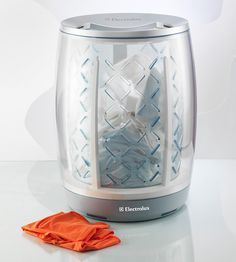 iBasket - The Hamper is the Washing Machine.  Starts automatically once it's full.  Automatically dries.  Sends a text to your phone when it's done.