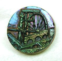 Antique Black Glass Button w Bright Carnival Luster Laxi Wheel Pictorial
