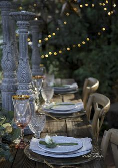 Soft lighting and wild flowers make an enchanting party setting. If you stick with pastels like blush and faded blue, mixing and matching is seamless.