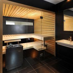 beautiful private sauna with a great mix of light wood and black tiles