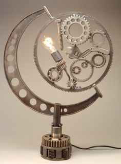"DruryLaneStudios @ etsy presents ""Machinist Lamp."" Serious whimsy straight ahead. A lamp with an Edison bulb, bearings, a wrench and lots of gears. And more gears. An extra heavy base keeps the lamp solid and sturdy.https://www.etsy.com/listing/229021094/a-different-kind-of-machinist-lamp-a?ref=shop_home_active_1"