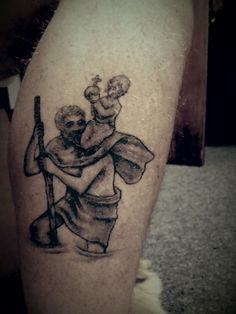 St Christopher tattoo, patron saint of safe travels.