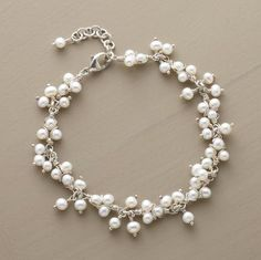"""Wrapped with sterling wire, luminous bundles of freshwater pearls drop and dance from this delicate bracelet. Sterling lobster clasp with 1"""" extension chain. Exclusive to Sundance. 7-1/2""""L."""