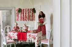 Scandinavian red and white checkered chairs and floral table cloth.. LOVE the chairs!
