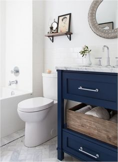 love the navy blue w the marble floors. (also herringbone floors, which are my current weakness)