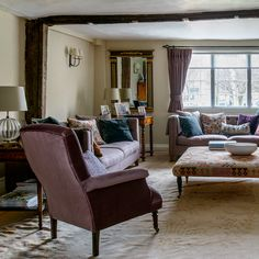 Country living room with purple velvet armchair
