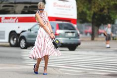 The Most Authentically Inspiring Street Style From New York #refinery29  http://www.refinery29.com/2015/09/93788/ny-fashion-week-spring-2016-street-style-pictures#slide-9  Stripes with a little added movement....