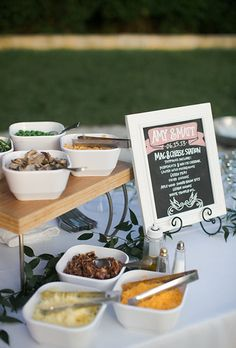 A mac-and-cheese station with a hand-lettered chalkboard menu.