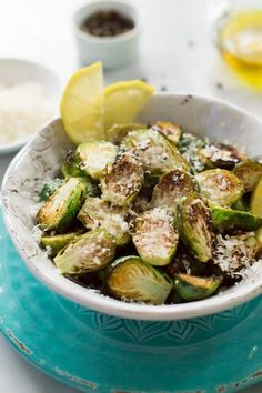 This easy to make Garlic Parmesan Roasted Brussels Sprouts is a delicious side dish made with lemon, parmesan, olive oil and lots of garlic.