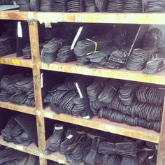 Tires cut into soles waiting their turn. Soles with soul.