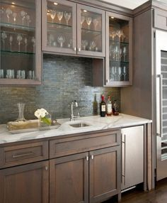 Alluring Small Wet Bar Designs For Basement Decorating Ideas in Home Bar Traditional design ideas with Alluring bar glass shelves gray-stained maple cabinets home bar kitchen cabinets lit cabinets Alder Cabinets, Staining Cabinets, Maple Cabinets, Glass Cabinets, Glass Shelves, White Cabinets, Kitchen With Wood Cabinets, Gray Stained Cabinets, Colored Cabinets