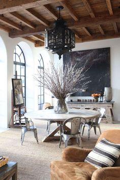beamed ceiling, large central table, steel framed oval doors...lovely