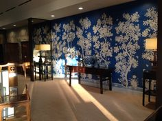 Stunning cobalt blue Gracie wallpaper with white silhouette design and lacquer finish - at the a Gracie showroom in the Dallas Design Center.