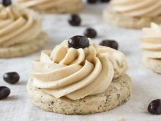 Irish Cream and Coffee Cookies - Coffee-flavored sugar cookies are topped with an Irish cream Italian meringue buttercream, transforming all of the flavors of the typical warm coffee cocktail into the perfect cookie.